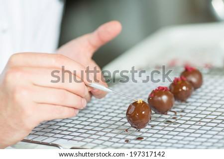 Preparation handmade chocolates - stock photo