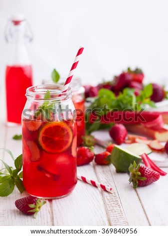 Preparation homemade refreshing  strawberry,lime and rhubarb lemonade with mint - stock photo