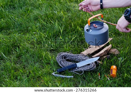 Preparation of hot water for tea or coffee in the camping - stock photo