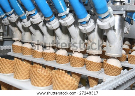 Preparation of ice-cream on factory - stock photo