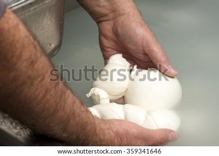 preparation of mozzarella in a dairy - stock photo