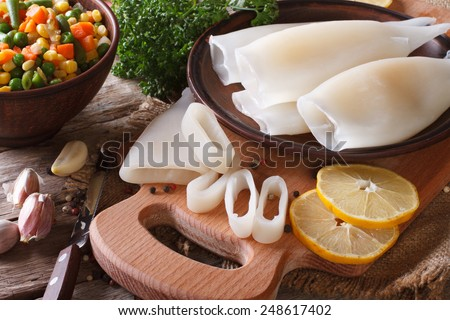 Preparation of raw squid and ingredients on the table close-up. horizontal  - stock photo
