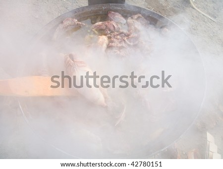 Preparation of sheep on a very long lunch - stock photo
