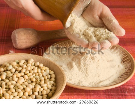 Preparation of soya flour by hand. - stock photo
