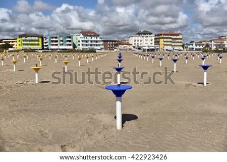 Preparation of the beach season. Set of beach umbrellas - stock photo