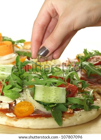 Preparation of the pizza with vegetables for dinner - stock photo