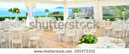 preparation restaurant tables for wedding  - stock photo