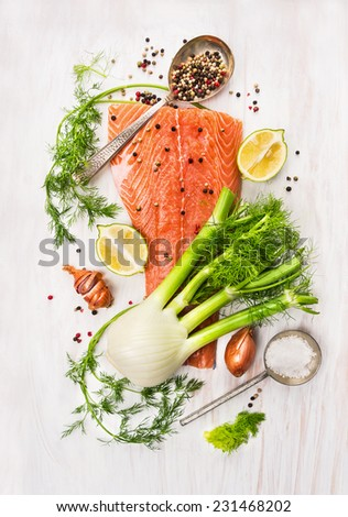 Preparation with raw salmon fillet,fennel, dill, lemon and onion on white wooden background, top view - stock photo