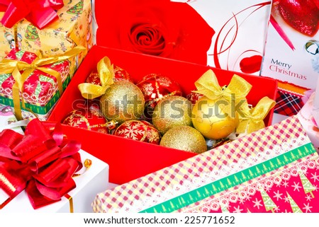 Preparations for the Christmas holiday. Gifts in festive packaging, decoration for Christmas tree, shiny balls with bows - stock photo
