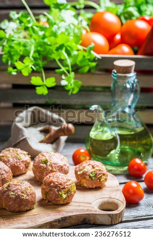 Preparations for the meatballs with meat and rice - stock photo