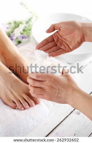 Prepare feet before the summer.Woman in a beauty salon for pedicure and foot massage. - stock photo