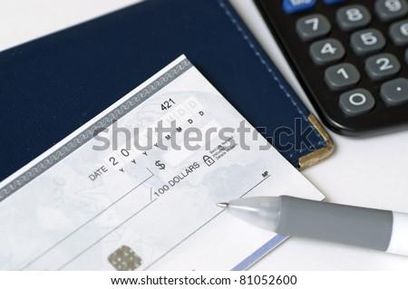 Prepare to write a check - stock photo