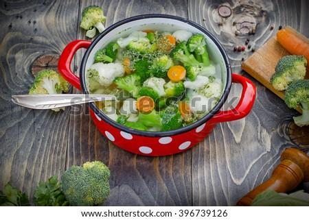 Prepare vegetable soup (raw vegetables) - vegetarian eating healthy food - stock photo