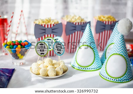 Prepared birthday table with beautiful decorations. - stock photo