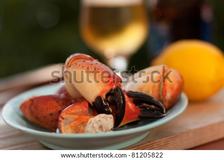 Prepared crab legs served with beer - stock photo