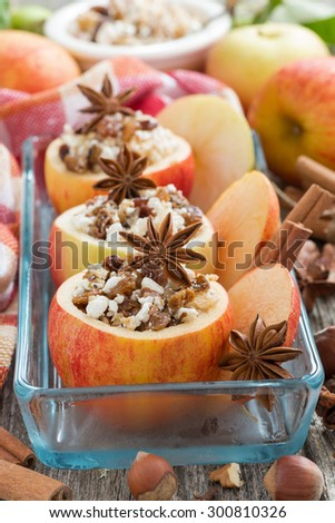 prepared for baking stuffed apples in a glass form, vertical, top view - stock photo