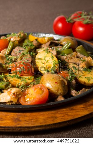Prepared meat stew served on a frying pan - stock photo