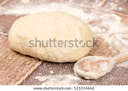 Prepared pizza dough on the table