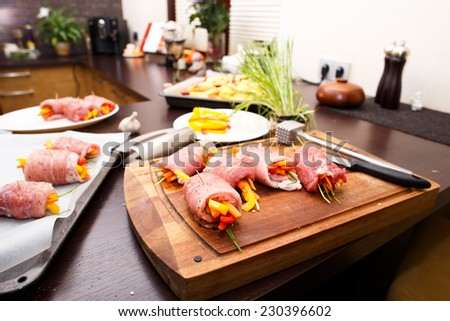 Prepared pork rolls with fresh vegetables ready to put into the oven - stock photo