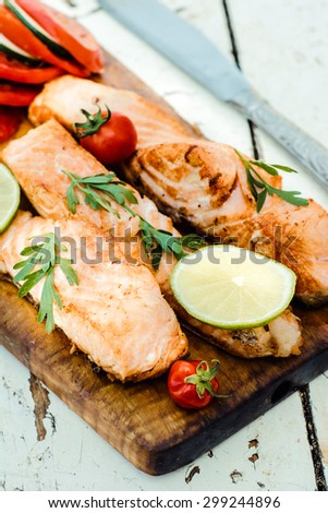 Prepared salmon fish on wooden board,selective focus