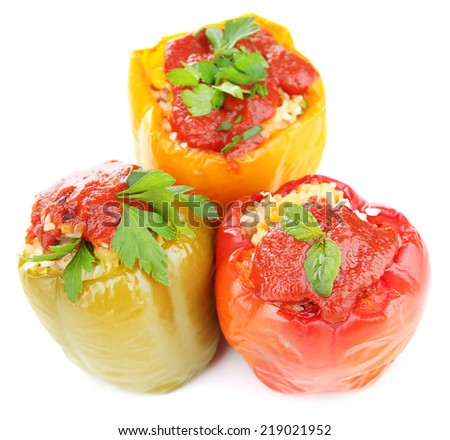 Prepared stuffed peppers with meat, rice and tomato sauce, isolated on white