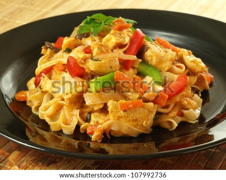 Prepared tagliatelle with vegetables and meat - stock photo