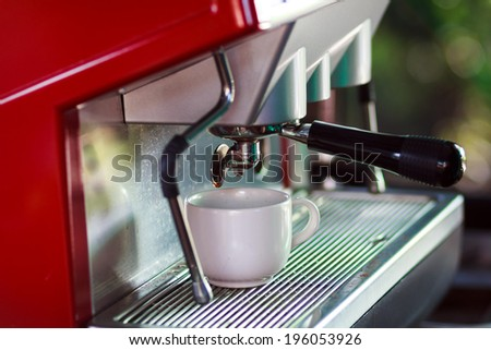 prepares espresso in his coffee shop - stock photo