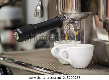 prepares espresso in his coffee shop  - stock photo