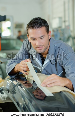 Preparing a car before spray painting - stock photo