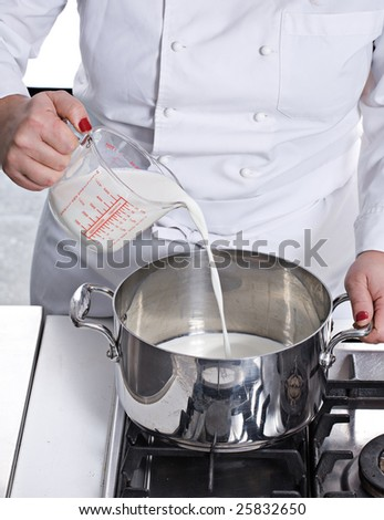 preparing cake pouring milk in to a pan - stock photo