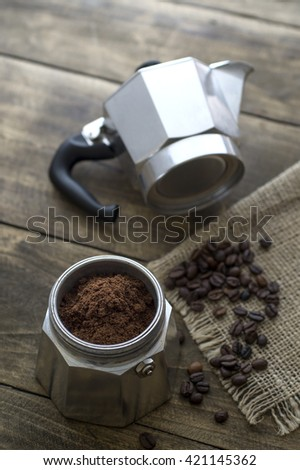 Preparing coffee with italian coffee maker, close up - stock photo