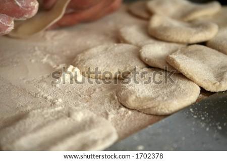 preparing dumpling dough, shallow dof - stock photo