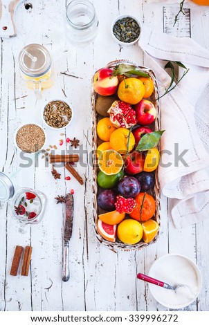 Preparing energy beverage, cocktail, juice with tropical, citrus fruits and berries. Colorful image rustic style. New breakfast trend with tropical fruit bowl. Pastel rustic style. - stock photo
