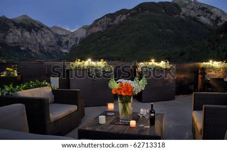 Preparing for a romantic evening on the deck with a view of the Ajax and Telluride peaks in Telluride, Colorado. - stock photo