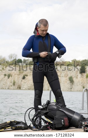 Preparing for dive, assembling scuba gear