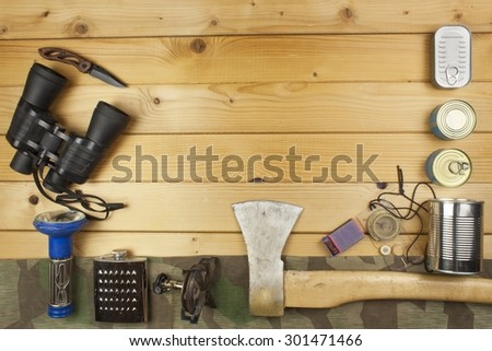 Preparing for summer camping. Things needed for an epic adventure. Sales of camping equipment. Packaging equipment for camping. Camping equipment on a wooden board. - stock photo