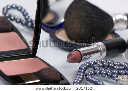 Preparing for the evening out....makeup and black pearls