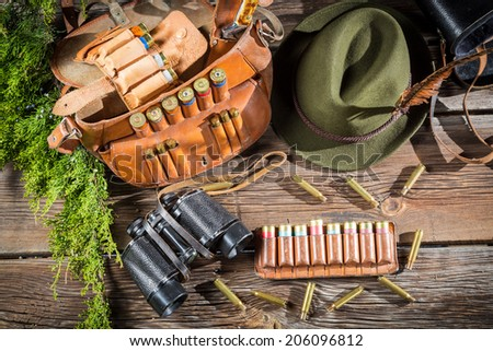 Preparing for the hunt in a forester cottage - stock photo