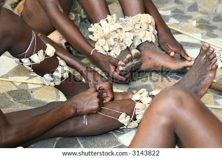 preparing for tribal hyena African dance , Basarwa bushman, San people, Botswana, - stock photo