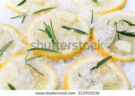 preparing Garlic and lemon confit - stock photo