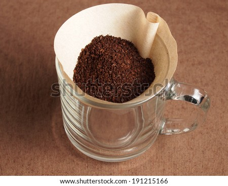 Preparing Grindded coffee crop on paper filter