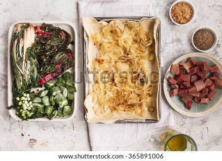 Preparing homemade fish Quiche with frozen vegetables. Ingredients for fish pie. - stock photo