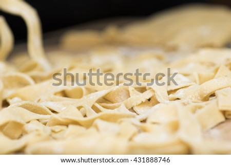 preparing homemade pasta for lasagna and tagliatelle, flour, eggs, water and salt. Italian food - stock photo