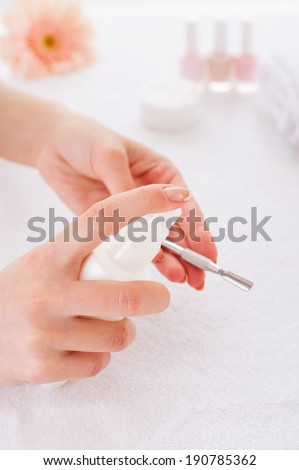 Preparing instruments for manicure. Close-up of manicure master preparing instruments for manicure