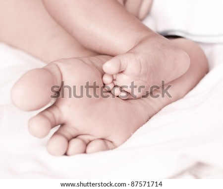 preparing of parent foot and baby foot - stock photo