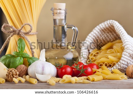 Preparing pasta with assorted ingredients - stock photo