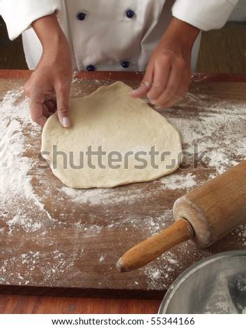 Preparing pizza dough. - stock photo
