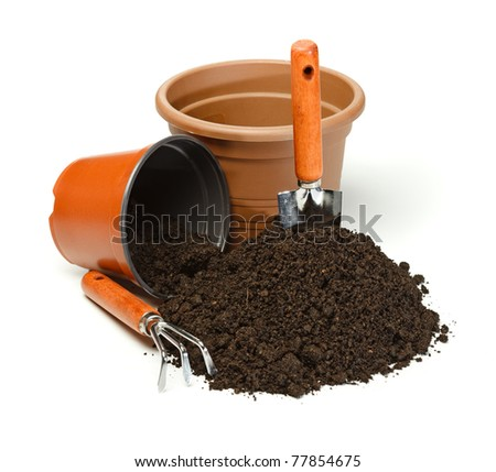Preparing potting with gardening tools and pots - stock photo