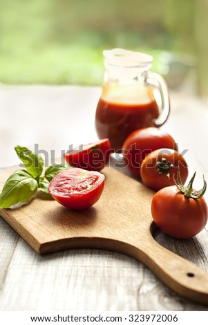 preparing salad with tomato - stock photo