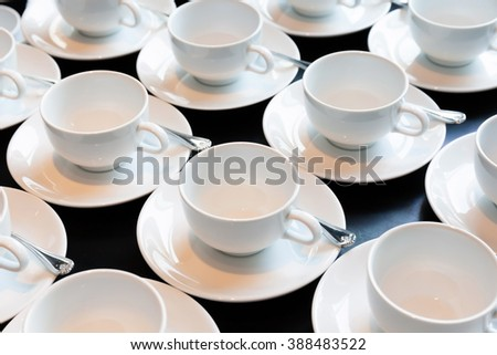 Preparing the new sets of coffee cup for conference breaking time. - stock photo